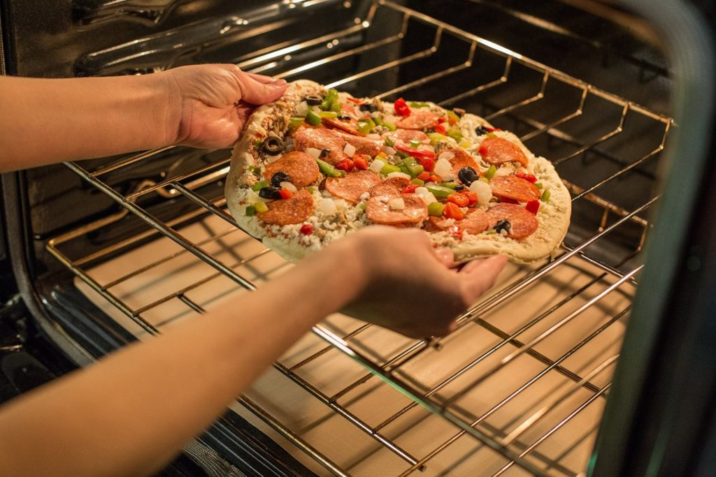 making pizza with oven liner